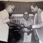 Former Illustrade Weekly editor the Late M V Kamath presents the first copy of Pandit Bhimsen Joshi by Mohan Nadkarni to Panditji in 1983.